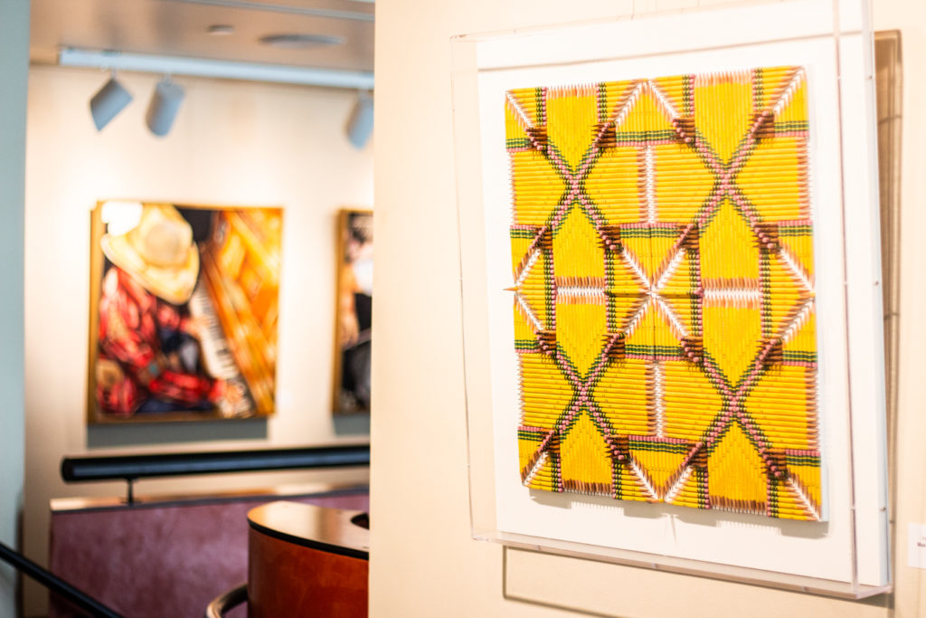 close up of woven art in art gallery