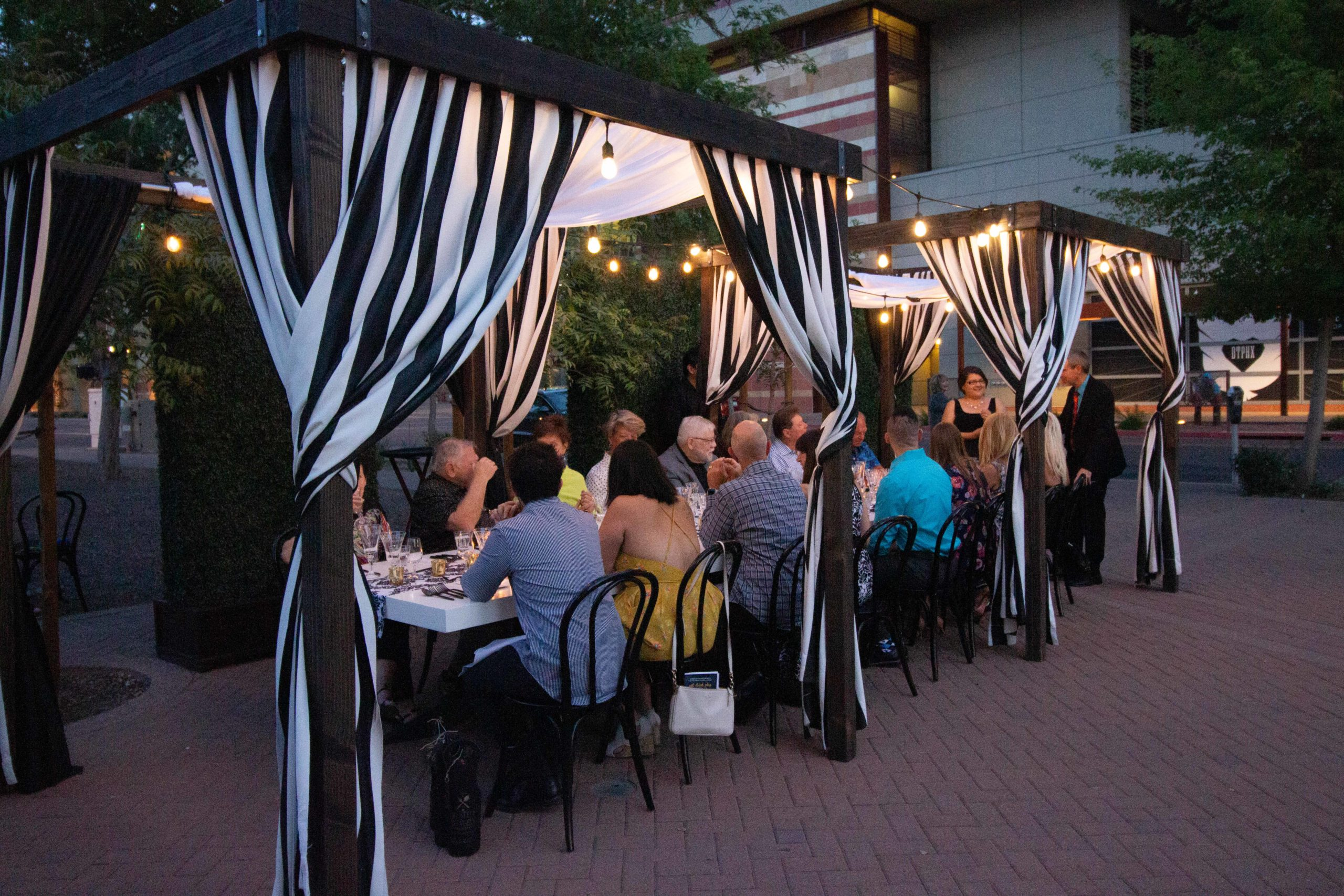 group at plated and staged event under outdoor canopy